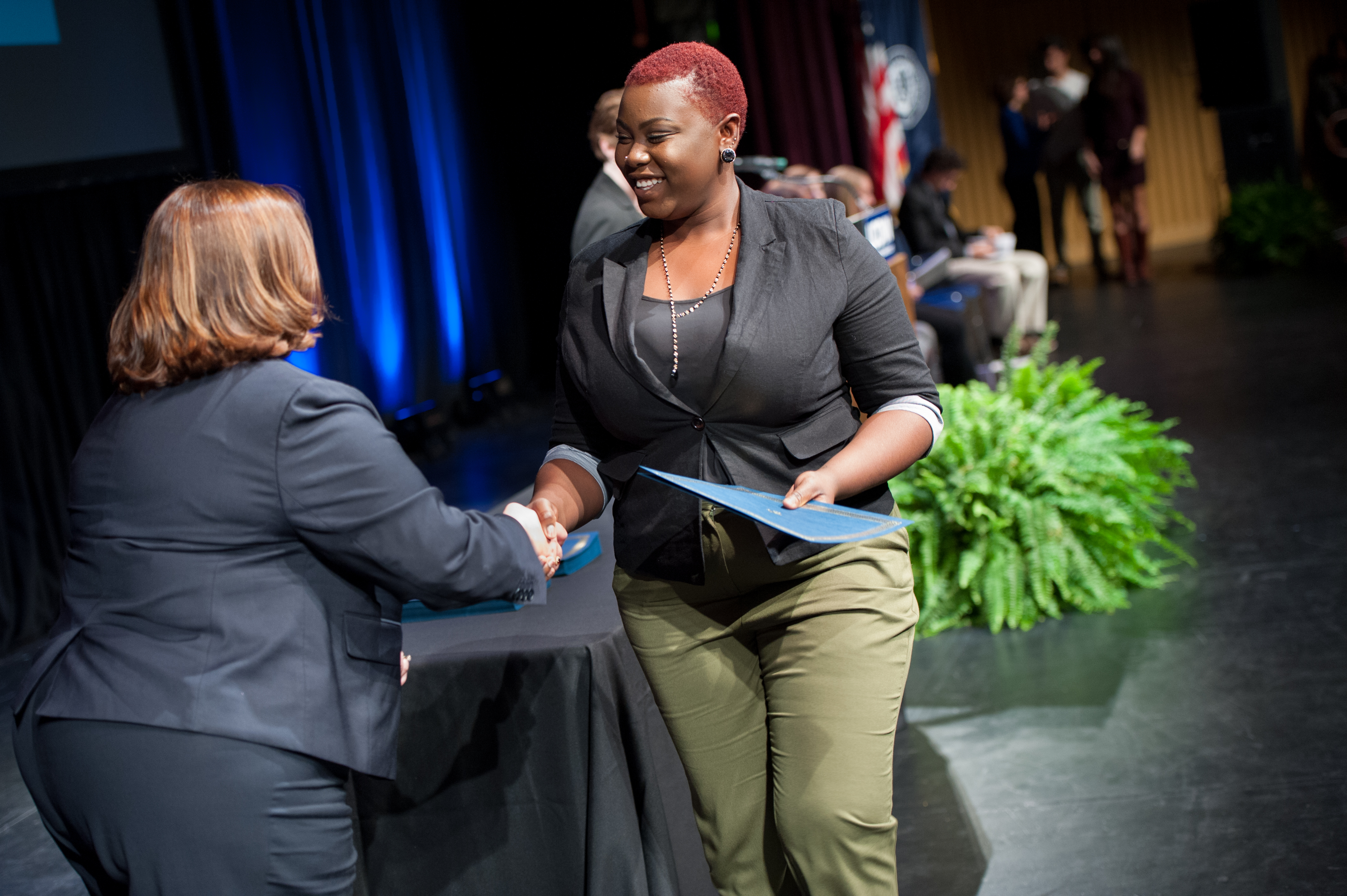 Jaydeen Sewell shaking hands